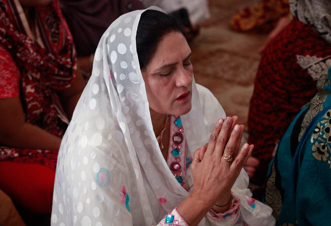 A Pakistani Christian prays while attending Easter celebrations at the Cathedral of the Sacred Heart of Jesus in Lahore April 8, 2012. ? Reuters Photo
