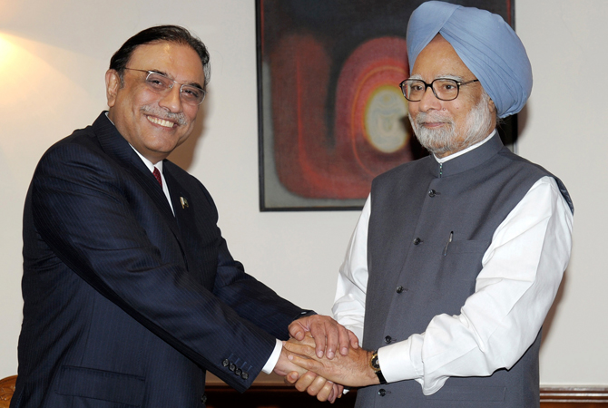 In this photo released by India's Press Information Bureau, Pakistan President Asif Ali Zardari, left, shakes hands with Indian Prime Minister Manmohan Singh prior to their meeting at the latter's residence in New Delhi, India. ? AP Photo