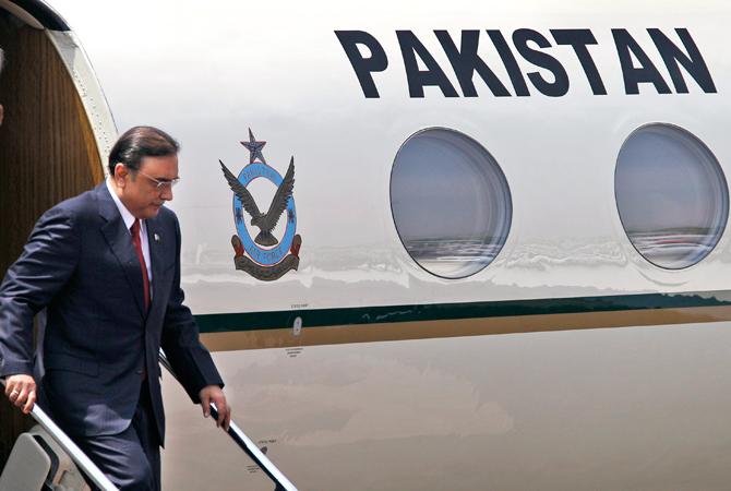 Pakistani President Asif Ali Zardari disembarks as he arrives at the Palam Airfield in New Delhi, India. ? AP Photo