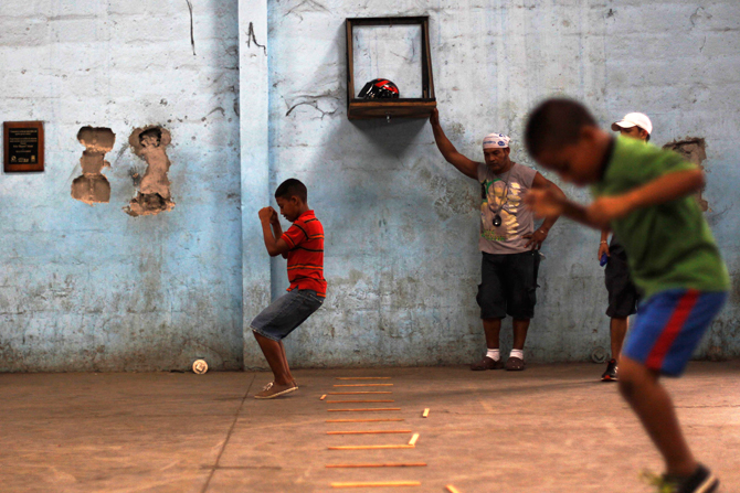 Children jump over wooden sticks during a training session at the Rockero Alcazar gym in the low-income neighbourhood of Curundu in Panama City. ? Photo by Reuters.