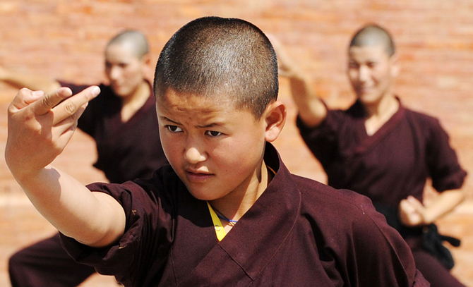 Buddhist nuns practise Kung-fu at the Amitabha Drukpa Nunnery on the outskirts of Kathmandu. ? Photo by AFP.