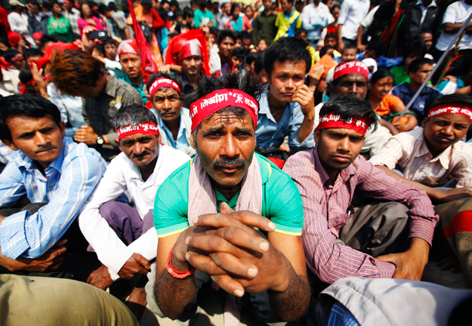Maoist activists and supporters, wearing Maoist headbands, attend an event to commemorate Labour Day in Kathmandu. ? Photo by Reuters.