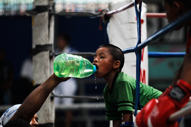 Ulises, 8, drinks water during a training session at the Rockero Alcazar gym in the low-income neighbourhood of Curundu in Panama City. ? Photo by Reuters.