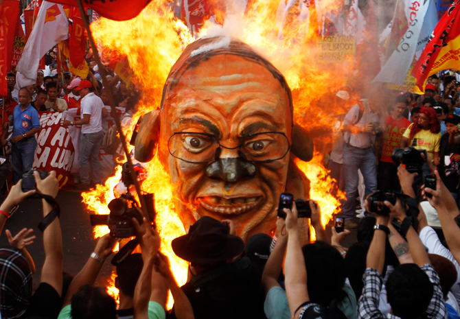 Protesters burn an effigy of President Benigno Aquino during a Labour Day march to press their demands for a 125 peso wage hike, during a protest outside the Presidential Palace. ? Photo by Reuters.