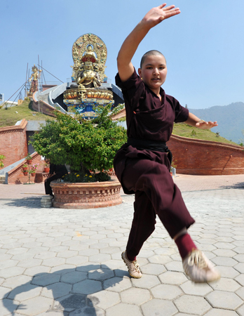 A Buddhist nun practises Kung-fu at the Amitabha Drukpa Nunnery on the outskirts of Kathmandu. ? Photo by AFP.