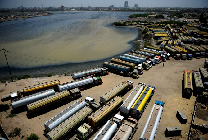 Tanker trucks, used to transport fuel to NATO forces in Afghanistan, are seen parked near oil terminals in Pakistan's port city of Karachi. Islamabad shut its Afghan border crossings to NATO supplies after US air strikes killed 24 soldiers last November. ? Photo by AFP