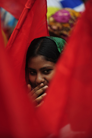 A Bangladeshi activist gestures during a procession to mark May Day or International Workers Day in Dhaka. ? Photo by AFP.