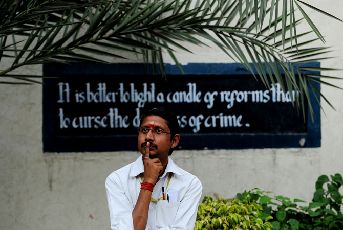 A man looks on near a prison ward during a concert at the Tihar jail in New Delhi on April 26, 2012.