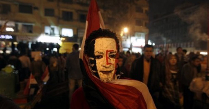 An Egyptian protester with the colours of the national flag on his face joins fellow protesters at Tahrir Square.—AP Photo