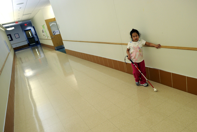 Maria Merano walks down the hall at the Concordia Learning Center at St. Joseph's School for the Blind in Jersey Cit , New Jersey.