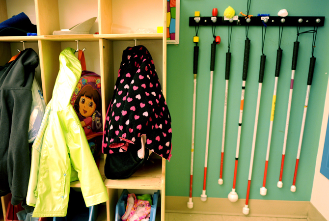 Walking canes hang next to the coat rack at the Concordia Learning Center at St. Joseph's School for the Blind in Jersey City, New.