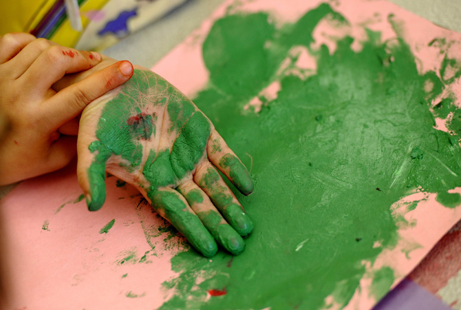 Children paint their hands in art class at the Concordia Learning Center at St. Joseph's School for the Blind in Jersey City, New Jersey.