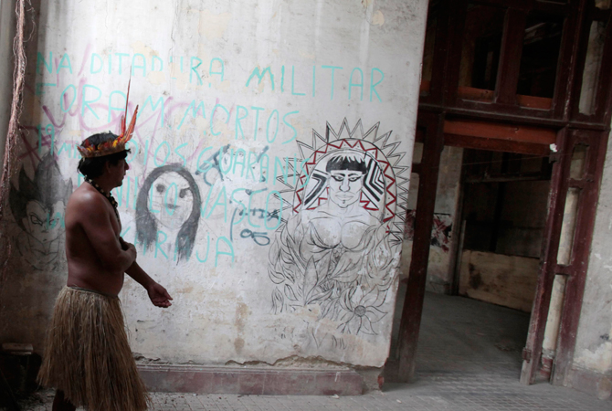 A Brazilian native Indian walks inside the former Indian Museum building in Rio de Janeiro.