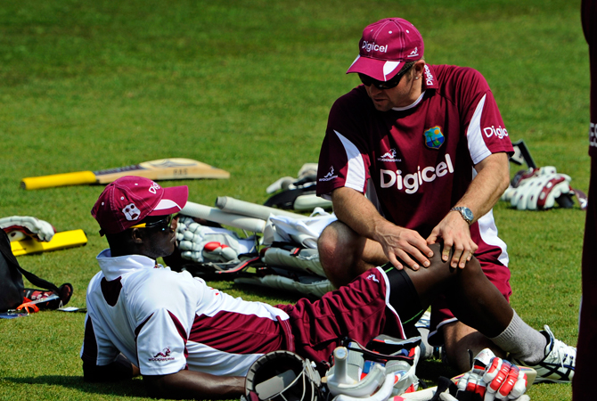 West Indies' Darren Sammy, left, is treated during a net practice session at the Trent Bridge cricket ground. ? Photo by AP