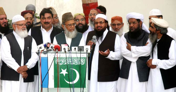 Difa-i-Pakistan Council leaders address a press conference in Karachiin this file photo   —F|ile Photo by APP Photo