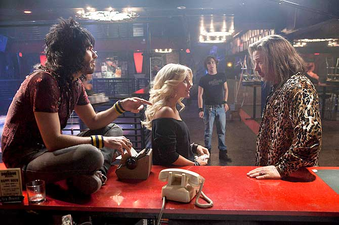 Actors Russell Brand (L), Julianne Hough, Diego Boneta and Alec Baldwin (R) are shown in a scene from the film ?Rock of Ages?
