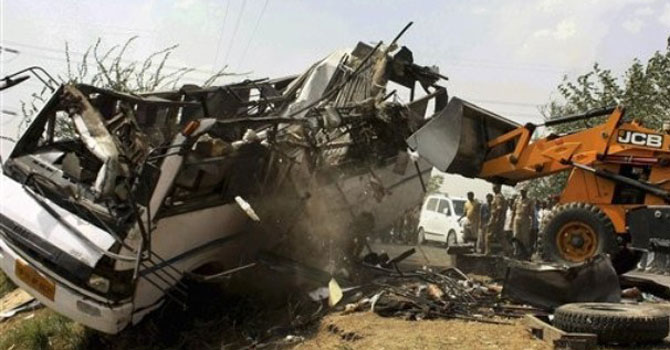 The wreckage of a passenger bus. — AP Photo