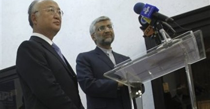 Iran's top nuclear negotiator, Saeed Jalili, right, and International Atomic Energy Agency (IAEA) chief Yukiya Amano, attend a news briefing at the conclusion of their meeting, in Tehran, Iran.—AP Photo