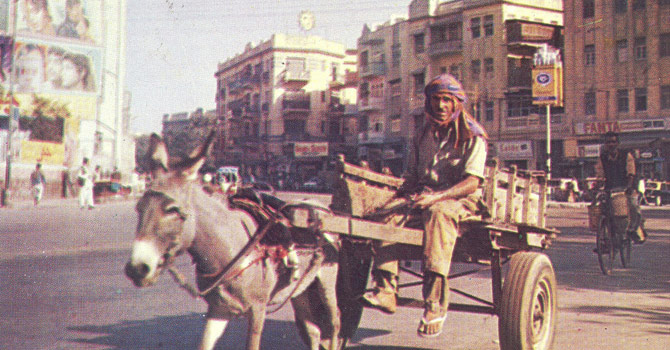 Karachi on the day the reactionary military junta led by Ziaul Haq toppled the Z A. Bhutto regime (July 5, 1977). In the background is a large cinema that closed down in the 1980s.