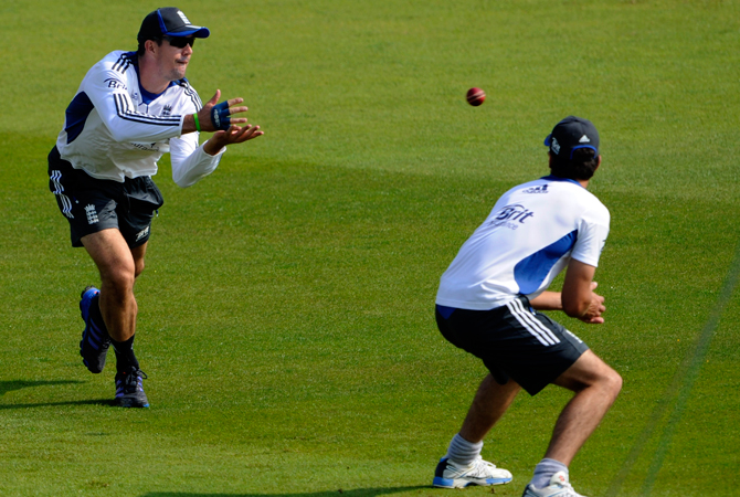 England's Kevin Pietersen, left, catches a ball during a net practice session. ? Photo by AP