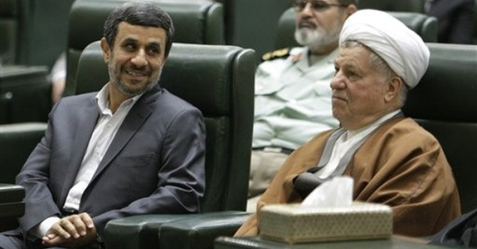 Iranian President Mahmoud Ahmadinejad talks to former President Akbar Hashemi Rafsanjani.—AP Photo