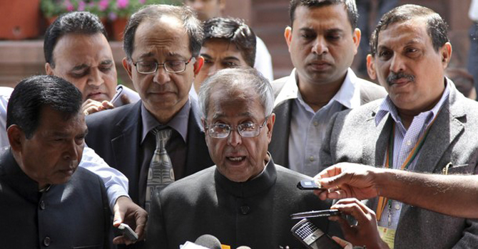 India's Finance Minister Pranab Mukherjee speaks with the media after presenting the 2011-2012 economic survey report, outside the parliament in New Delhi.—Reuters Photo