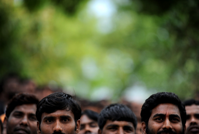 Prisoners focus their gaze on a stage set up inside the Tihar jail in New Delhi on April 26, 2012, during a small concert at the penal facility.