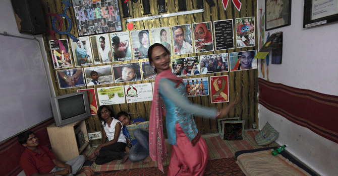 Seema, 33, dances inside a local non-governmental organisation (NGO) office, which supports sexual minorities, in New Delhi.—Reuters Photo