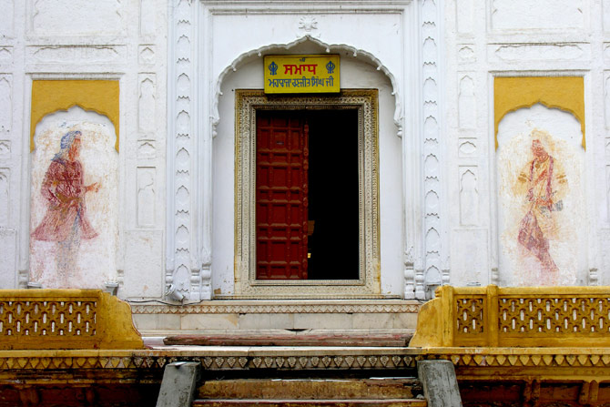 The eastern facade of Maharaja Ranjit Singh's Samadhi. It has frescoes of guardian figures that Dr Nadhra Shahbaz Naeem Khan found after scraping thick layers of whitewash. They have since been covered with more layers and lost again. – Photo courtesy Nadhra Shahbaz Naeem Khan for Hosh Media/Dawn.com