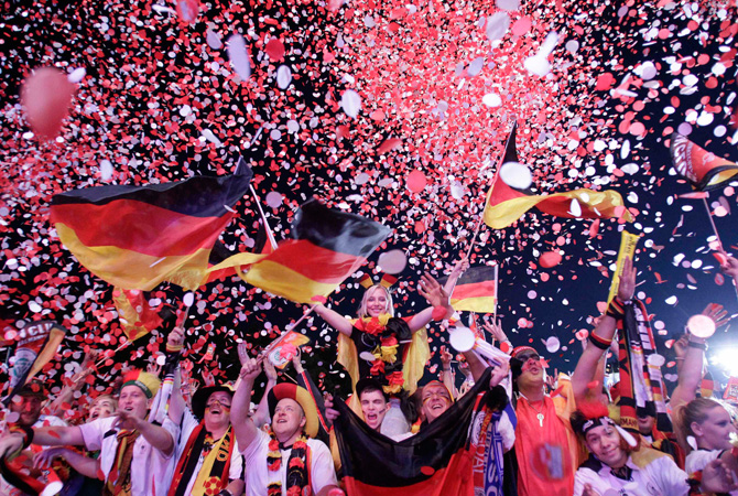 Football fans react during a public screening after Germany won their Euro 2012 quarter-final soccer match against Greece.