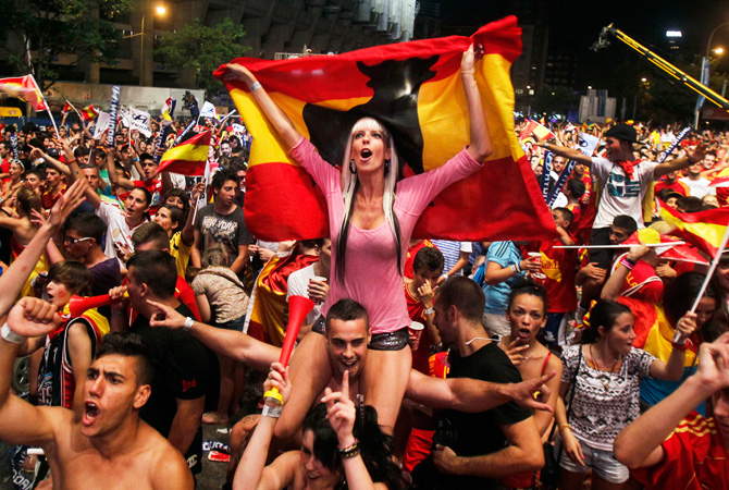 Spanish fans celebrate during the viewing of the Euro 2012 soccer championship semifinal match at the Fan Zone in Madrid. ? Photo by AP