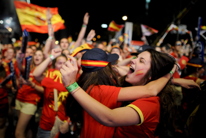 Supporters of the Spanish national football team celebrate the victory during the Euro 2012 Championships football match between Spain and France. ? Photo by AFP