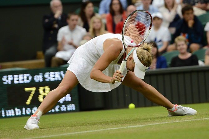 Denmark's Caroline Wozniacki slips on the grass during her first round women's singles match against Austria's Tamira Paszek. – Photo by AFP