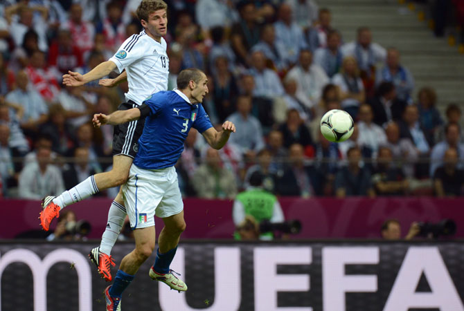 German forward Thomas Mueller vies with Italian defender Giorgio Chiellini during the Euro 2012 semi-final match.