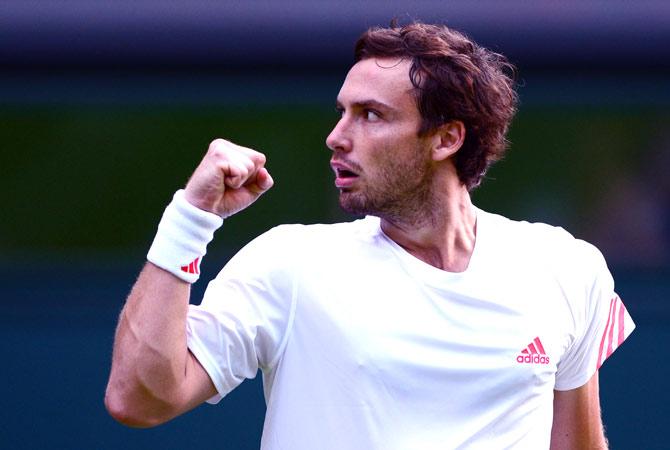 Latvia's Ernests Gulbis celebrates his first round men's singles victory over Czech Republic's Tomas Berdych on the first day of the 2012 Wimbledon Championships tennis tournament at the All England Tennis Club in Wimbledon, southwest London, on June 25, 2012. ? AFP Photo