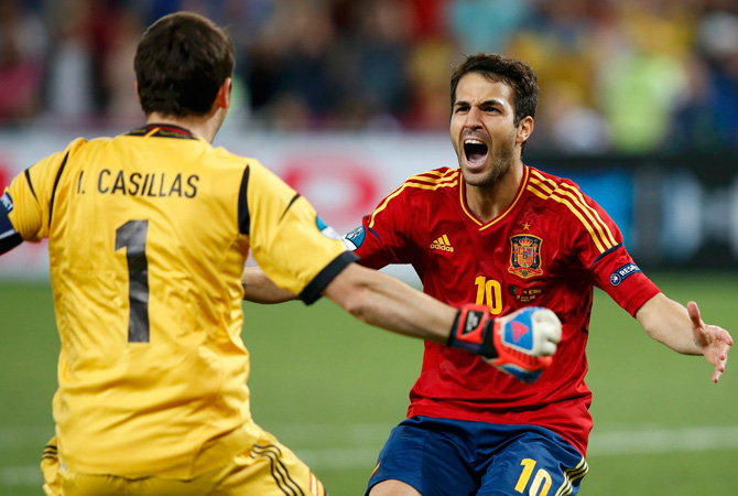 Spain's Cesc Fabregas celebrates with goalkeeper Iker Casillas after scoring the winning penalty goal against Portugal during the penalty shoot-out. ? Photo by Reuters