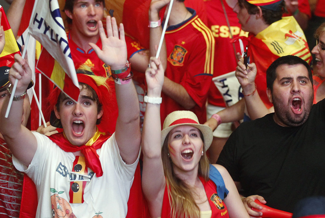 Supporters celebrate Spain's victory after their Euro 2012 quarter-final soccer match against France at a fan mile in Madrid. ? Photo by Reuters