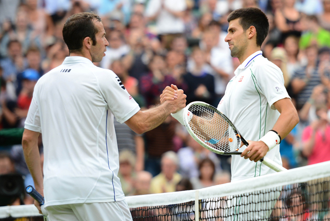 Serbia's Novak Djokovic (Right) shakes hands with Czech Republic's Radek Stepanek his third round men's singles victory on day five of the 2012 Wimbledon. ? Photo by AFP