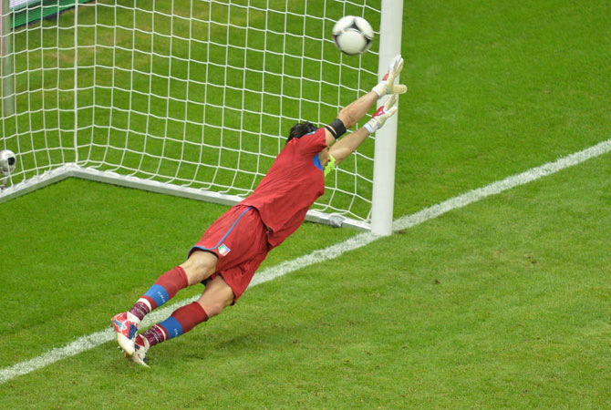 Italian goalkeeper Gianluigi Buffon fails to stop a penalty kick.