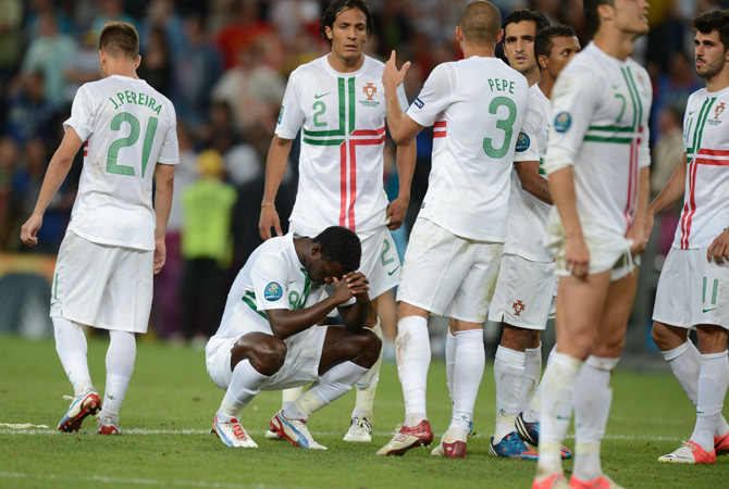 Portugal players reacts after losing the Euro 2012 football championships semi-final match. ? Photo by AFP