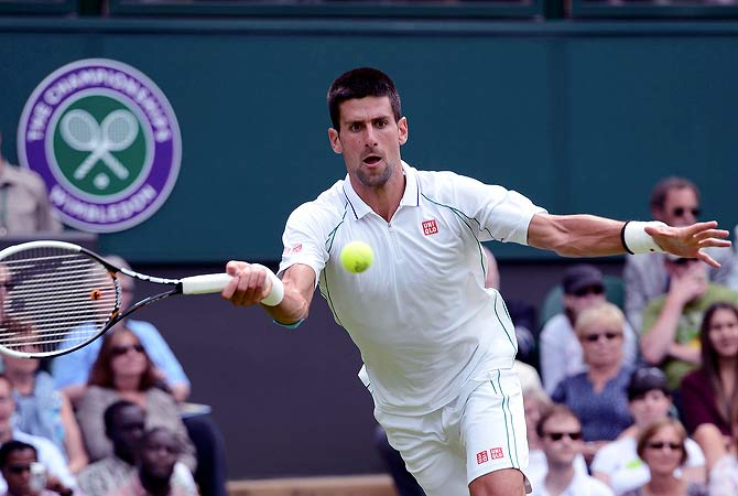 Novak Djokovic of Serbia hits a return to Juan Carlos Ferrero of Spain during their men's singles tennis match at the Wimbledon tennis championships in London June 25, 2012.  ? Reuters Photo