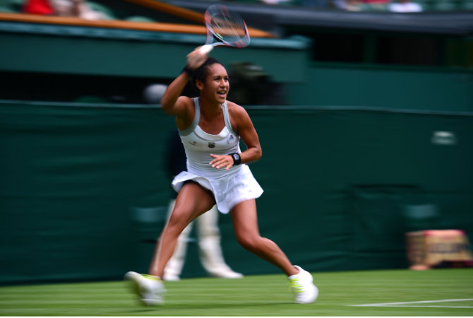 Britain's Heather Watson plays a shot during her first round women's singles victory over Czech Republic's Iveta Benesova on the first day of the 2012 Wimbledon Championships tennis tournament at the All England Tennis Club in Wimbledon, southwest London, on June 25, 2012. ? AFP Photo