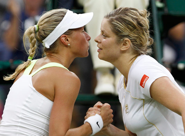 Kim Clijsters of Belgium (R) acnknowledges Andrea Hlavackova of the Czech Republic after defeating her in their women's singles tennis match. – Photo by Reuters