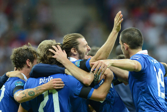 Italian players celebrate after beating Germany in the semi-finals.