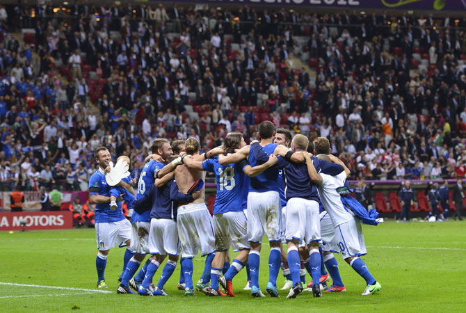 Italy's national football team celebrate their victory at the end of the Euro 2012 semi-final match.