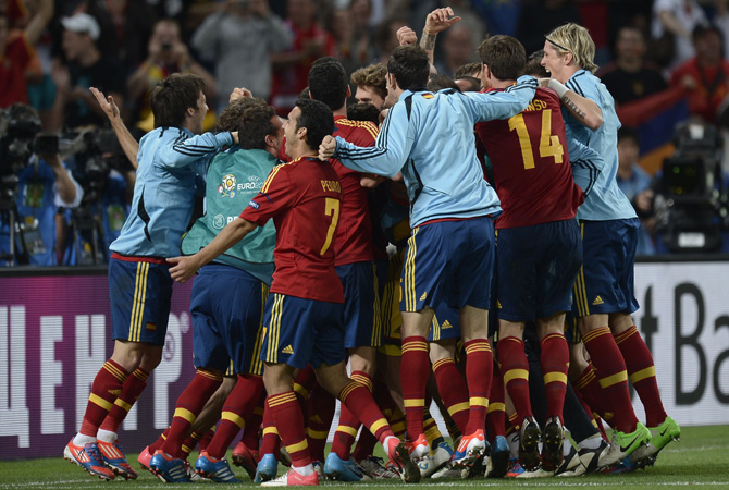 Spanish players celebrate after winning the Euro 2012 football championships semi-final match Portugal vs Spain. ? Photo by AFP