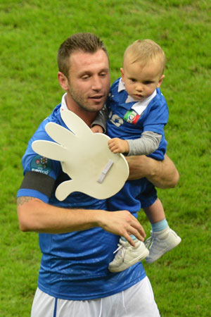 Italian forward Antonio Cassano celebrates with his son after winning the Euro 2012 football championships semi-final match.
