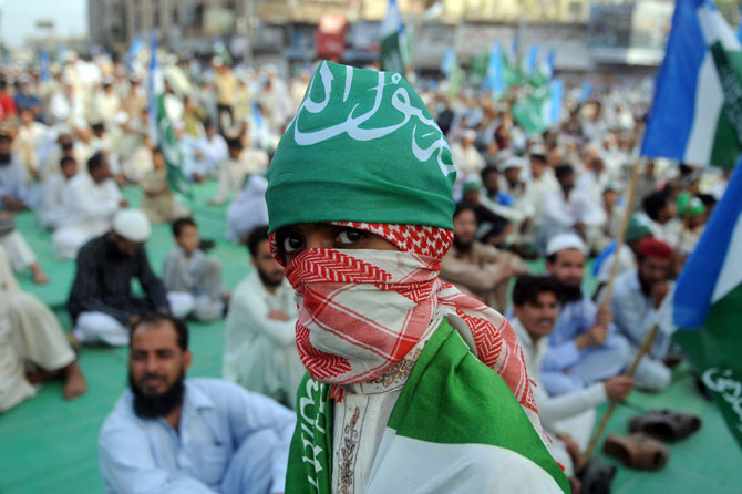 A supporter of Jammat-e-Islami (JI) looks on during a protest in Karachi on June 10, 2012, against the government's plan to reopen NATO supplies route to Afghanistan. – Photo by AFP