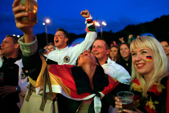 Germany football supporters react after their team scored during the Euro 2012 quarter-final match between Germany and Greece.