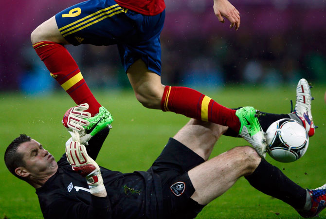 Spain's Fernando Torres (top) jumps over Ireland's goalkeeper Shay Given during their Group C Euro 2012 football match. ? Photo by Reuters